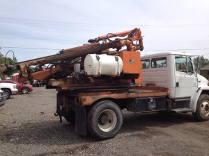 FL-70, Sterling Single Axle Used Highway (2000 pound hammer) Guardrail Post Driver with Remote Drive ROCK DRILL