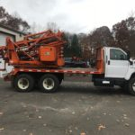 USED Tandem Axle GRT Post Driver WITH AUGER